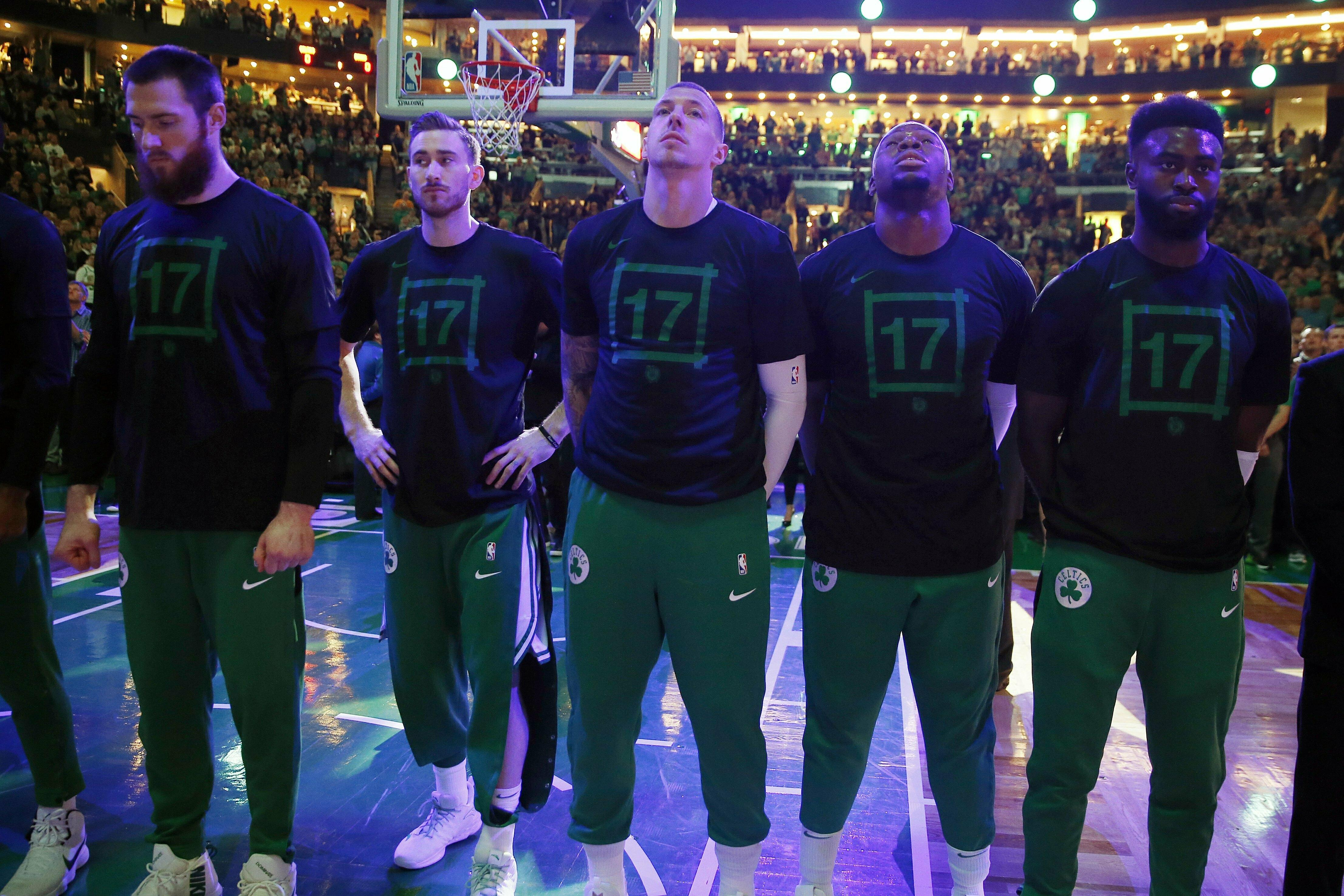 bb61def6 Boston Celtics wear the No. 17 during a moment of silence for former Celtic  John