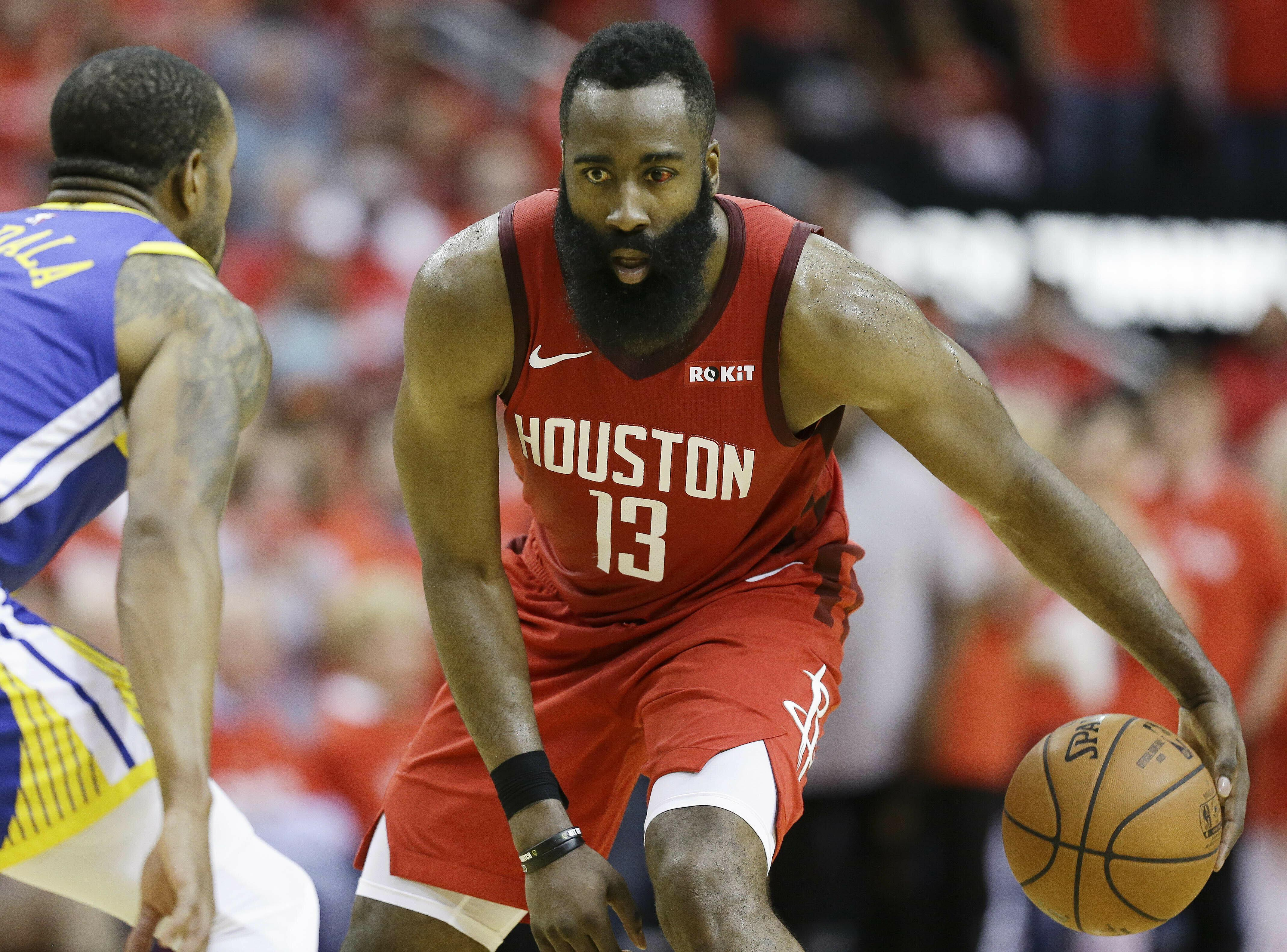 51870582c69 Houston Rockets guard James Harden (13) dribbles as Golden State Warriors  guard Andre Iguodala
