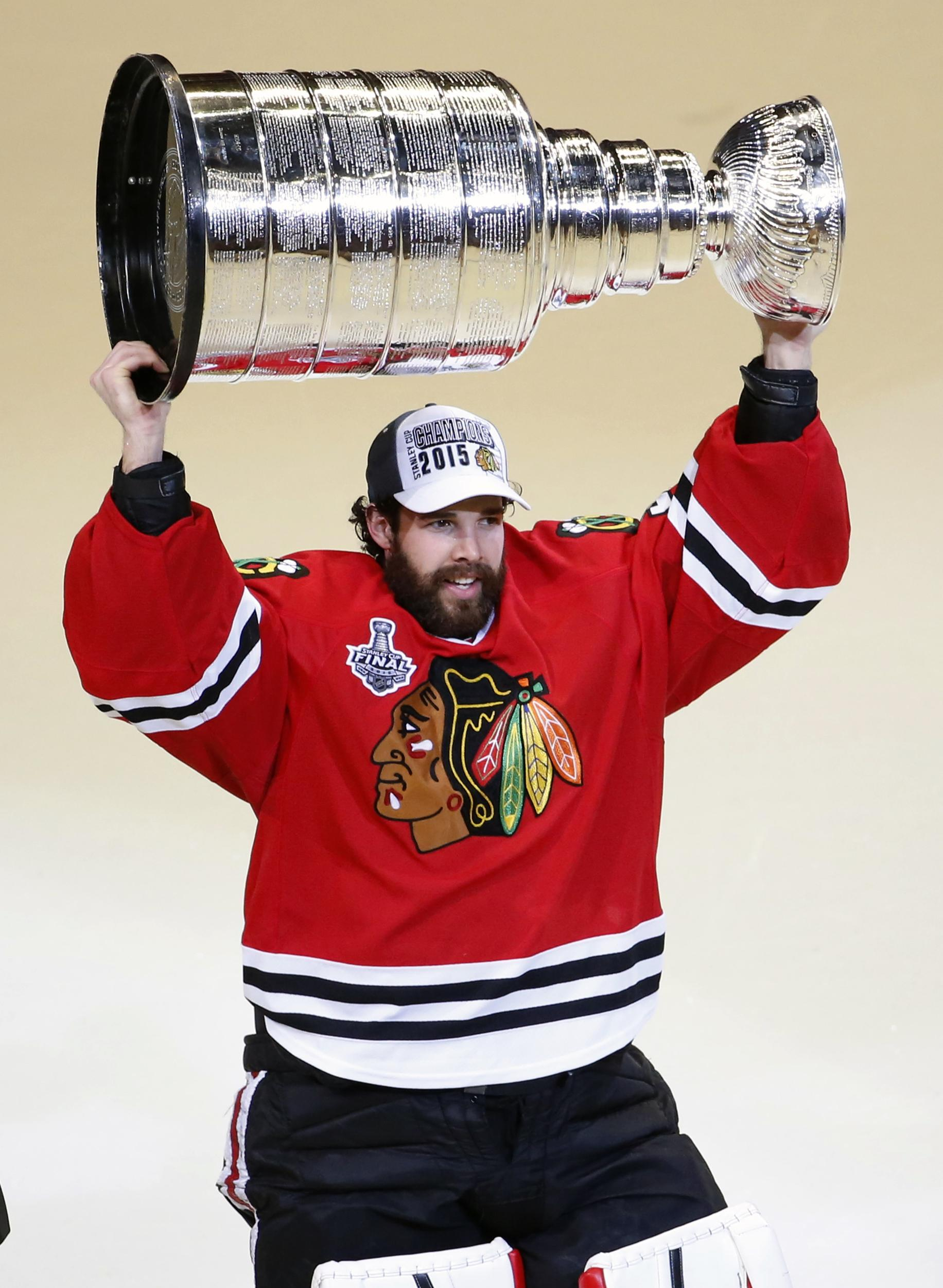 741cd8d1 In this June 10, 2015 photo, Chicago Blackhawks' goalie Corey Crawford  hoists the