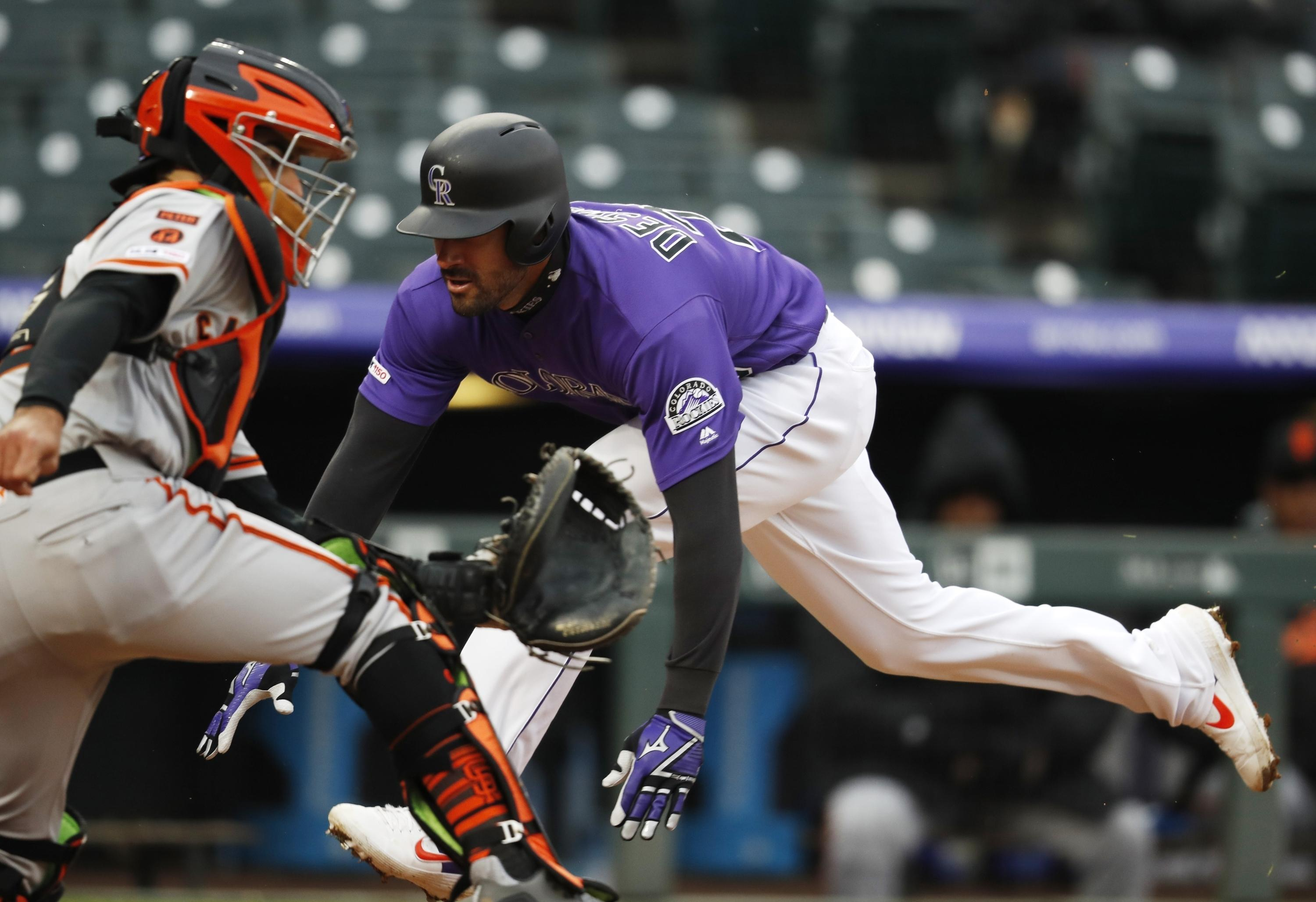 a517d1d74ae MLB roundup  Rockies rally to beat Giants 12-11 at wintry Coors ...