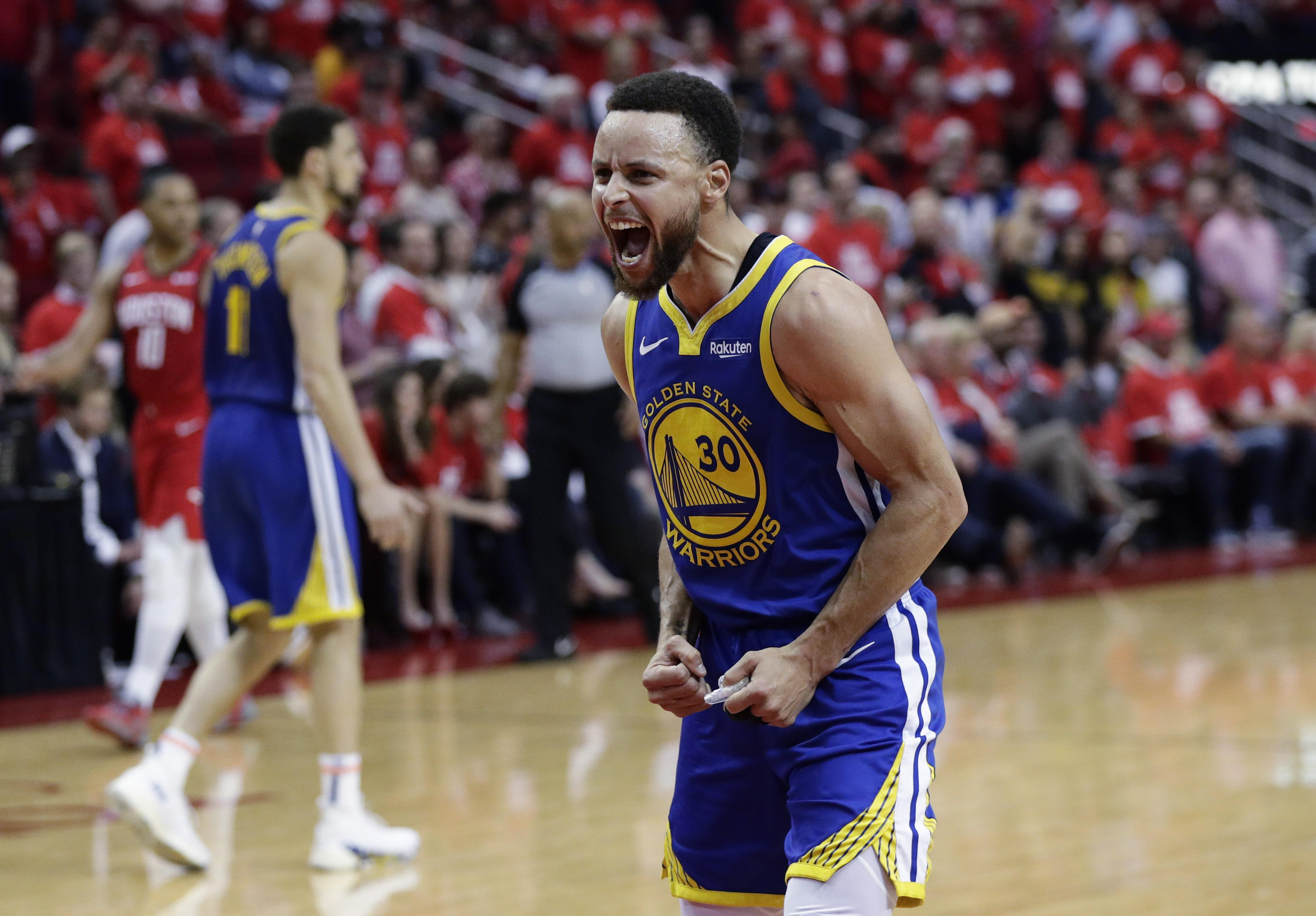 2a6a8a049457 Golden State Warriors guard Stephen Curry (30) celebrates the team s win  over Houston in