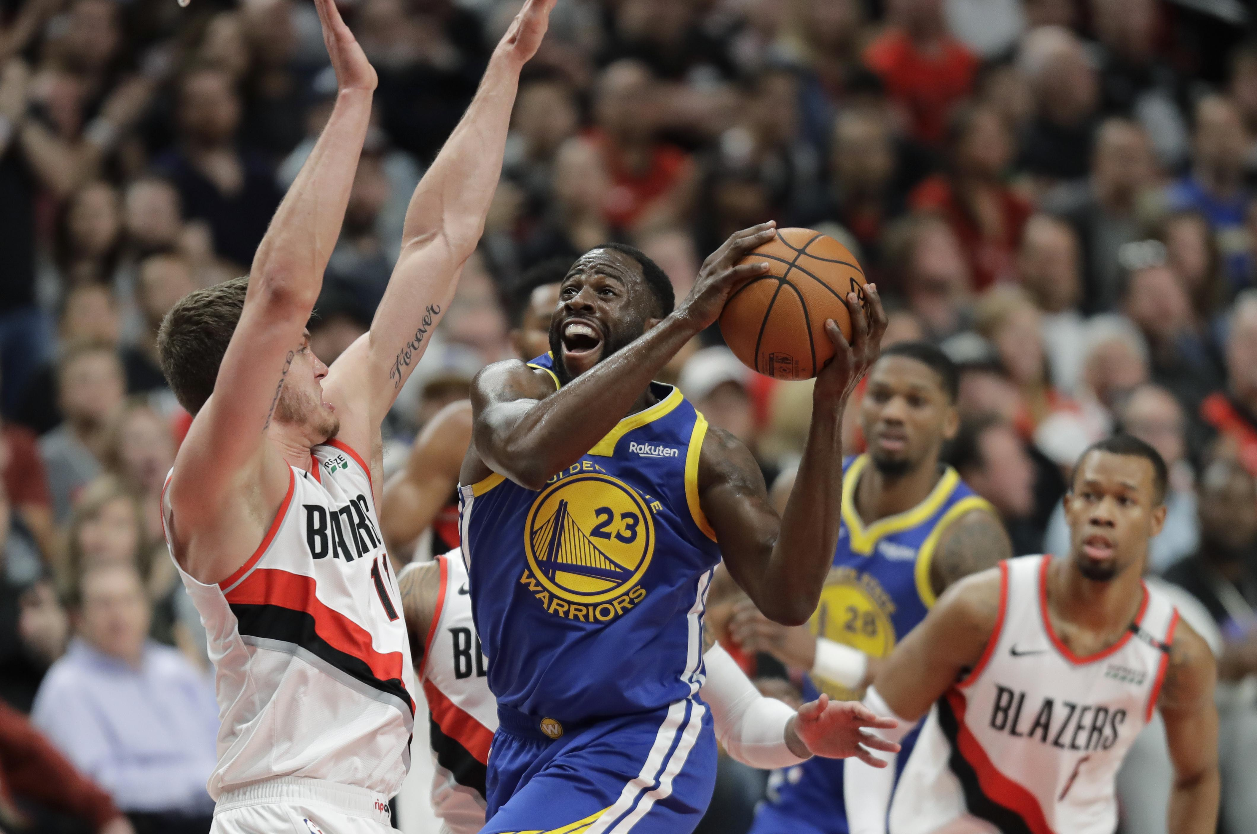 c1cfb597ec61 Golden State Warriors forward Draymond Green shoots against Portland Trail  Blazers forward Meyers Leonard during the