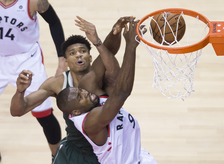 1dce4e6bdd3 Toronto Raptors center Serge Ibaka battles for the ball against Milwaukee  Bucks forward Giannis Antetokounmpo during