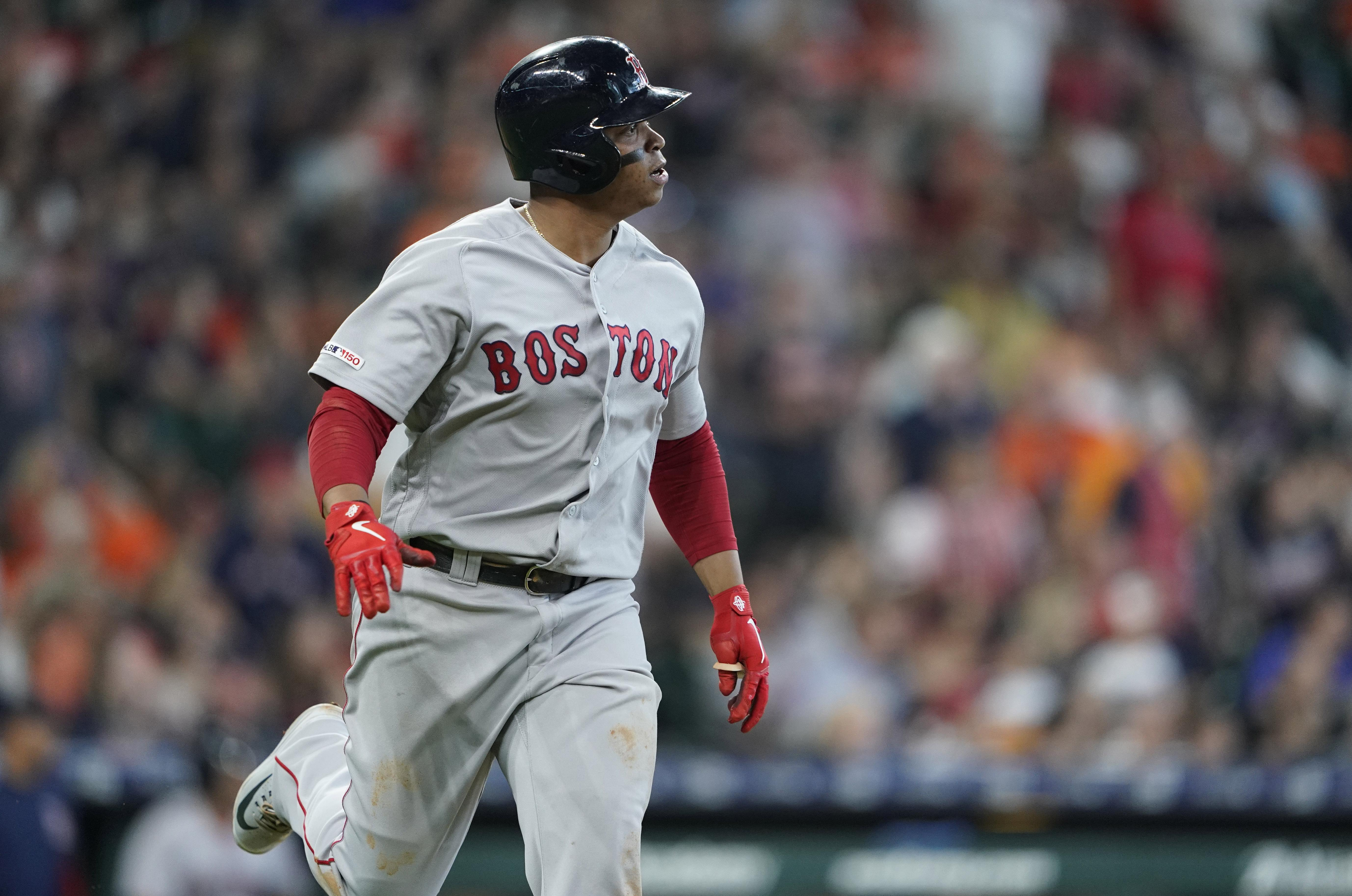 ffb0c277b27 Boston Red Sox s Rafael Devers watches his home run against the Houston  Astros during the fourth