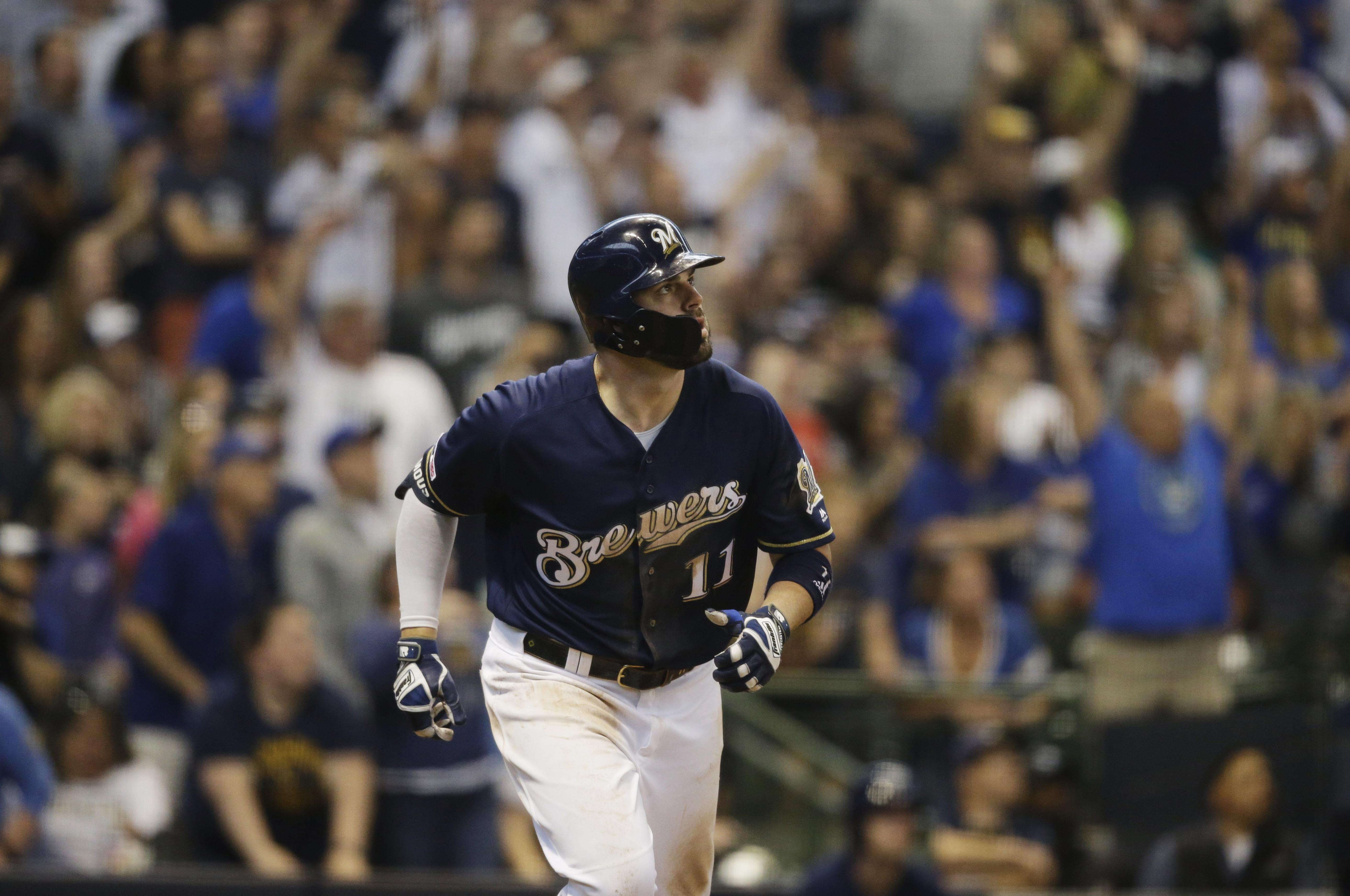 2e2fde8b Milwaukee Brewers' Mike Moustakas watches his two- run home run against the  Pittsburgh Pirates