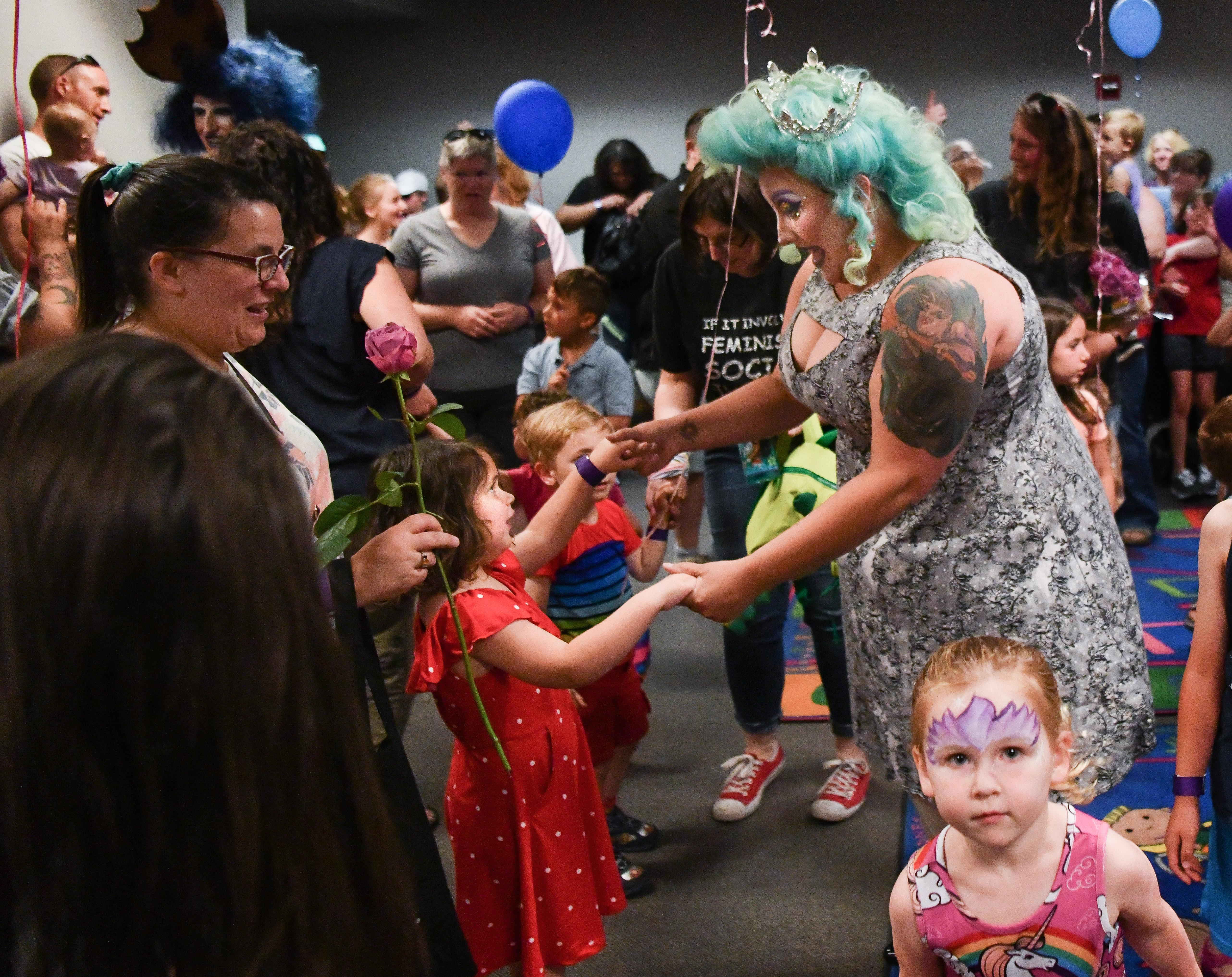 """Drag Queen Story Hour: """"Love your family no matter what"""