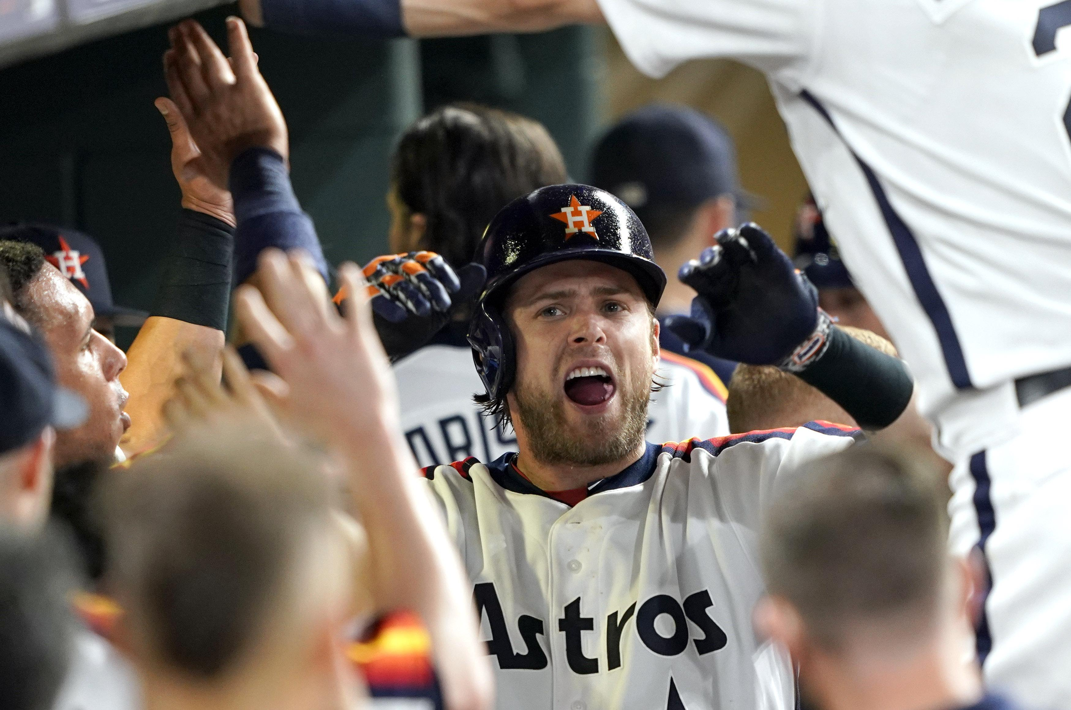 separation shoes 310da 26db6 Houston Astros  Josh Reddick celebrates in the dugout after hitting a home  run against the