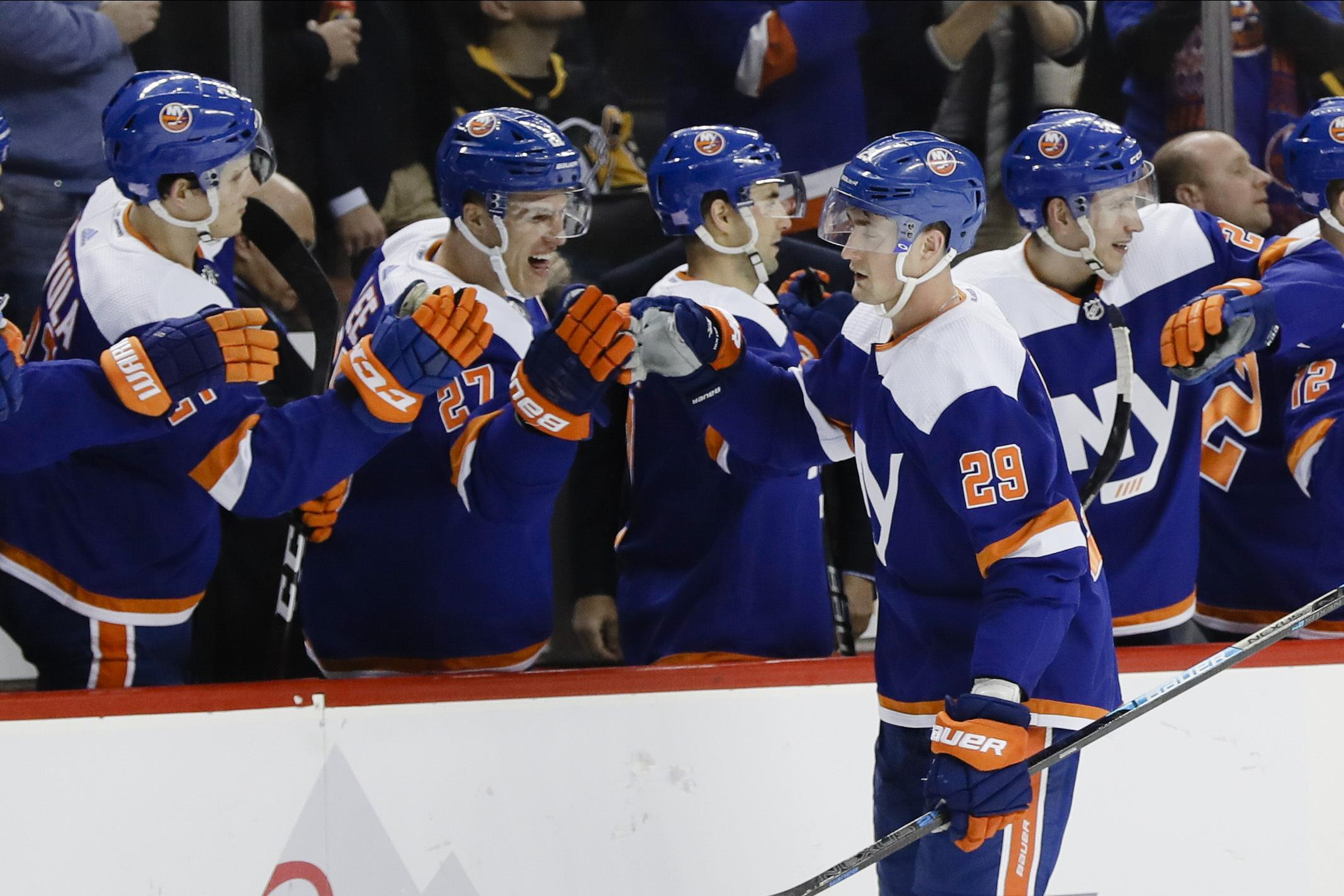 Islanders beat Penguins, 4-3 in OT; point streak at 16 games