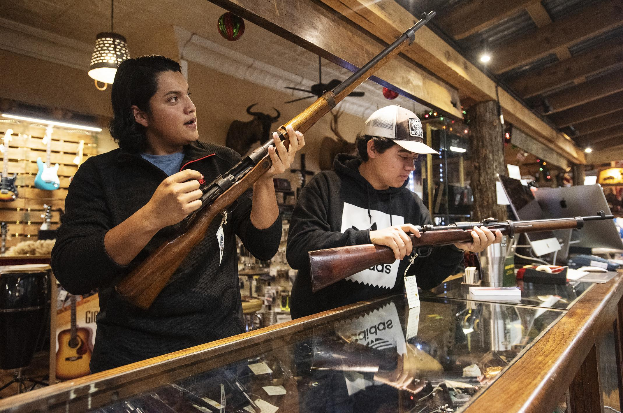 National gun sales reach record while new laws slow gun purchases ...