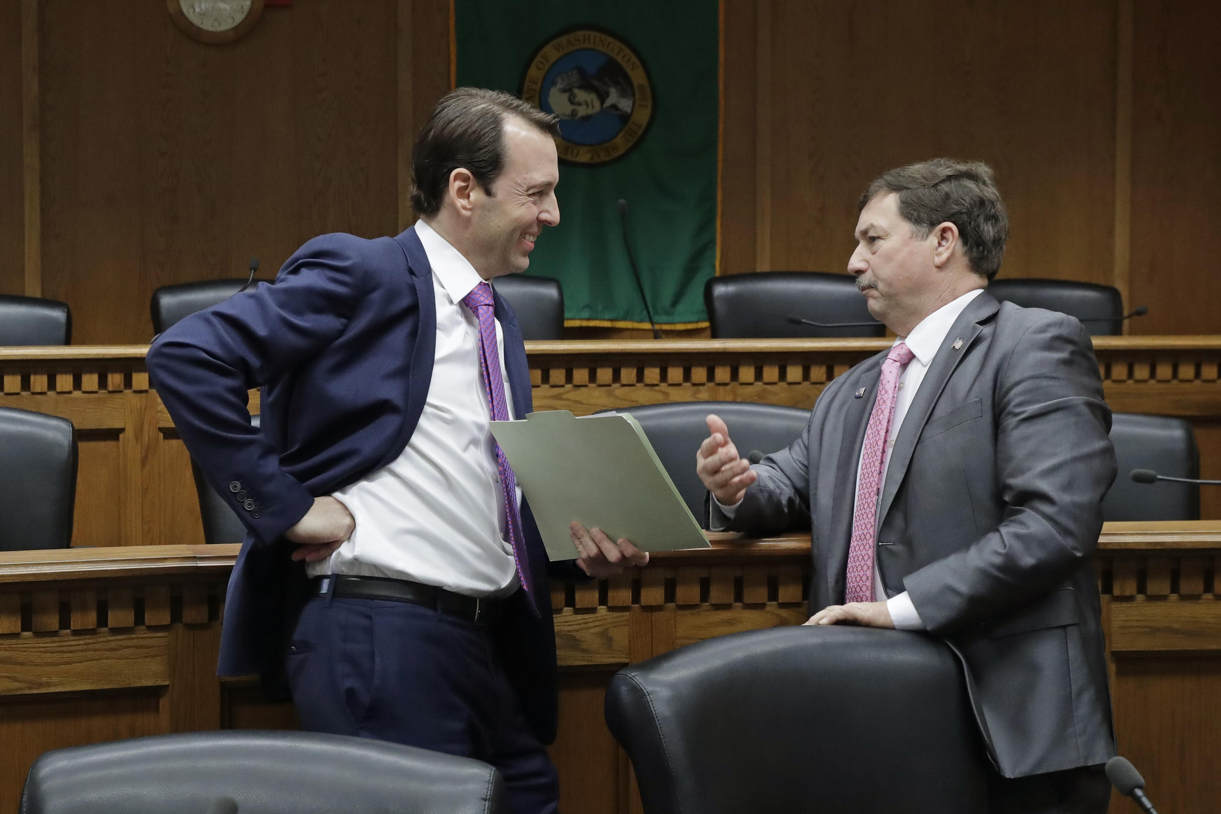 Senate Majority Leader Andy Billig, D-Spokane, left, talks with Senate Minority Leader Mark Schoesler, R-Ritzville, right, after they took part in a legislative preview on Thursday, Jan. 9, 2020 in Olympia. Much of the legislature's work in the short session is likely to make incremental changes to laws, writes veteran political reporter Jim Camden