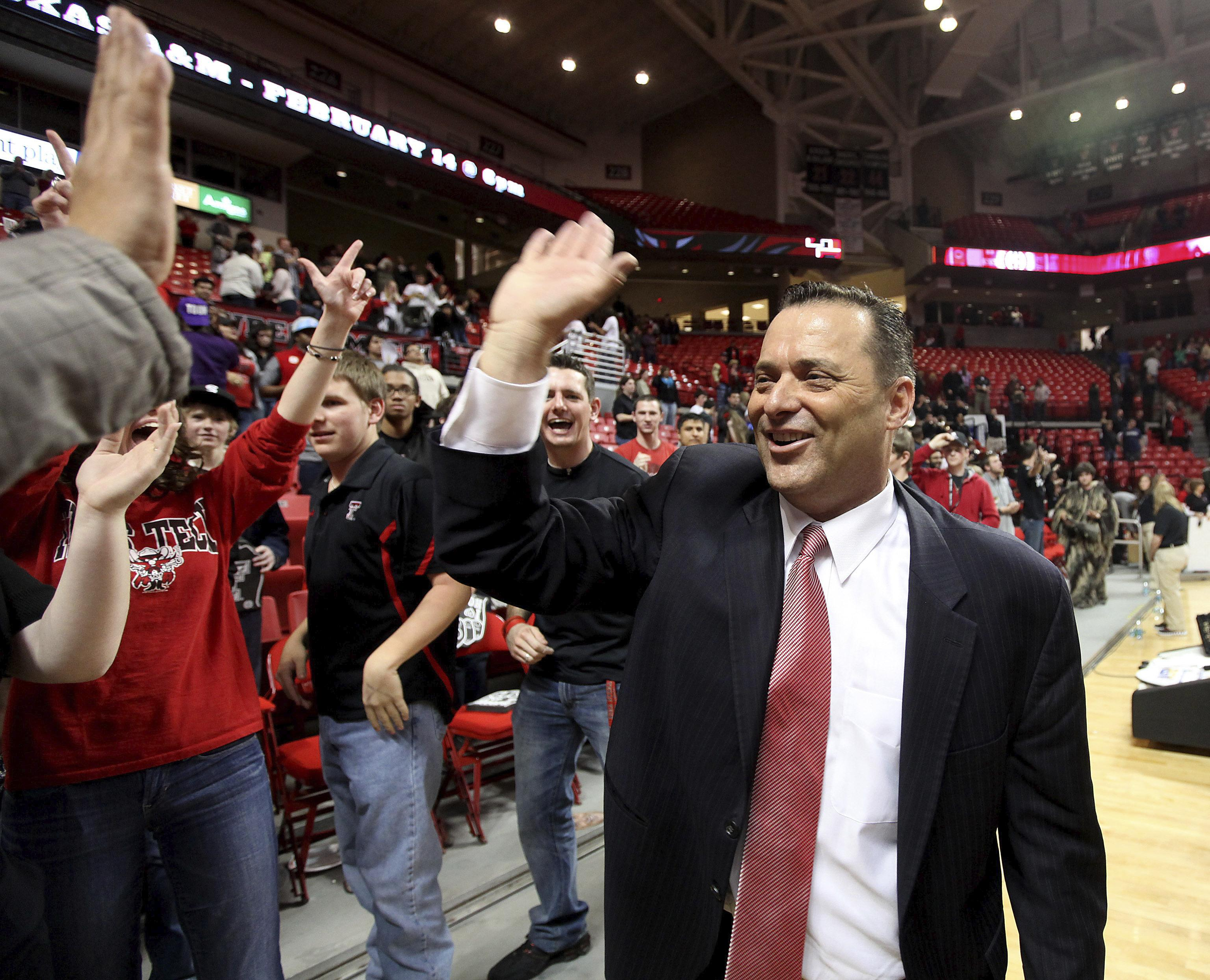 Texas Tech coach Billy Gillispie celebrates with fans after defeating Oklahoma in an NCAA college basketball game in Lubbock Texas. Gillispie was named head coach at Tarleton State taking over a program making the transition