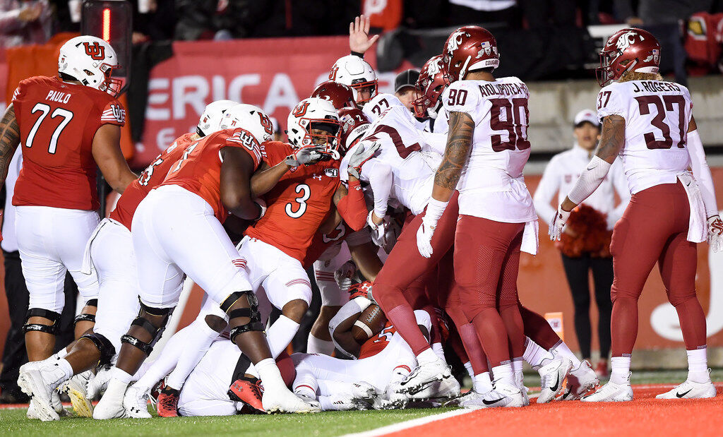 The Washington State Cougars stop the Utah Utes near the goal line during the second half of a college football game on Saturday