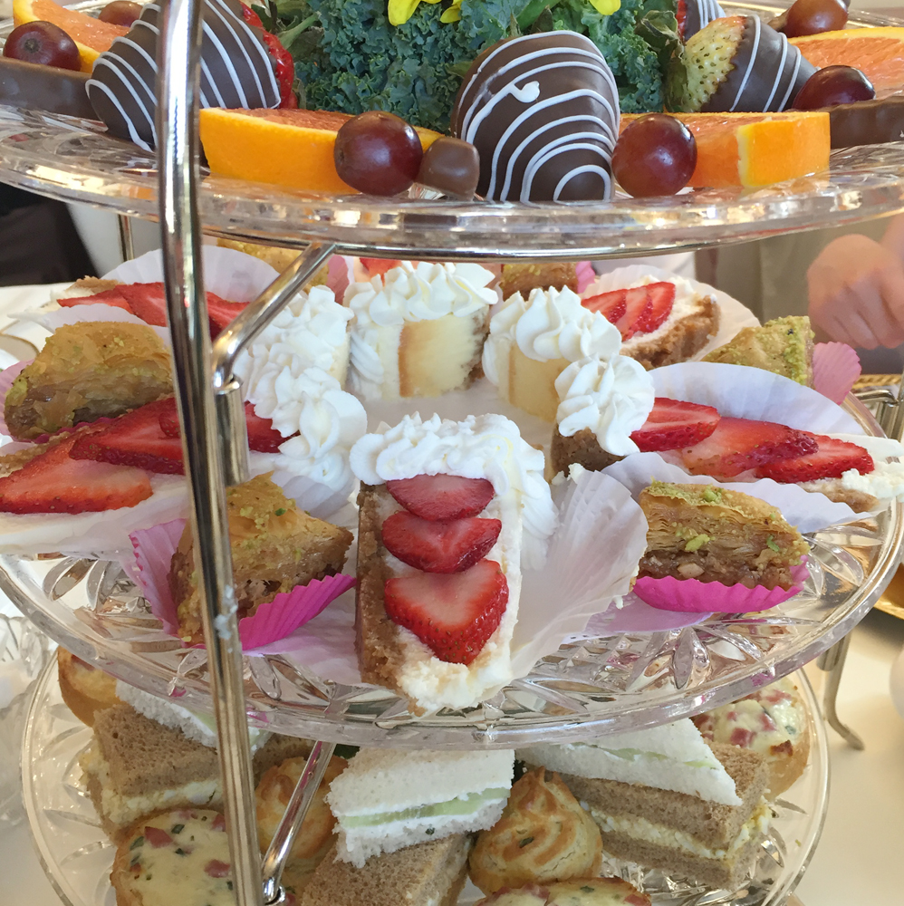 Assortment of sandwiches, dessert and fruit at Silver Spoon Tea House.